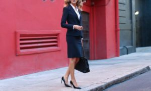 An escort can be dressed as a professional business woman